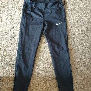 Medium Nike leggings with side pockets and mesh